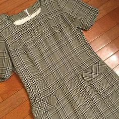 Available @ Ally Fair.  A personal favorite from my Etsy shop https://www.etsy.com/listing/468541072/vintage-houndstooth-dress