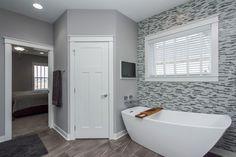Stella is Italian for star. #JacuzziLuxuryBath Stella® bathtub showcases a distinct, yet gentle form in a stunning freestanding bath. [photo by Happe Homes]  http://www.jacuzzi.com/baths/bathtubs/stella-freestanding-bath/