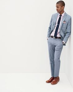 J.Crew men's Ludlow suit jacket in microstripe Italian cotton, slim cotton-linen shirt, Ludlow suit pant in microstripe Italian cotton, tie in mini-herringbone, arrow tie bar, tipped Italian linen pocket square, classic leather belt with removable silver-plated buckle, Mougin & Piquard™ chronovintage watch and Alden® for J.Crew waxed longwing bluchers.