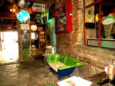 Guests at Szimpla Kert may even sit in an old bathtub while enjoying the amazing atmosphere of the oldest ruin pub in Budapest.