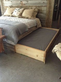 Wooden dog bed attached to main bed. If you have a dog that loves to sleep in your room here is the perfect co-sleeping arrangement.
