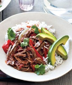 Cuban Braised Beef and Peppers. One of my favorite slow cooker recipes. Inspired by a dish called ropa viejo, it's best served as it's shown here: with rice, avocado slices (salted), and fresh cilantro.