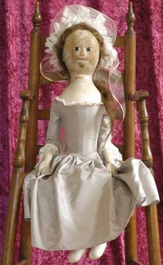 Proctor Doll: Late 18th century wood with silk gown.  Possible other clothing per portraits?