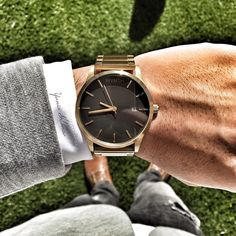 Formal attire complimented by a gold x black MVMT Watch.