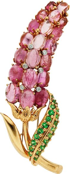 Vintage brooch... Oval-shaped pink tourmaline cabochons @ 13.00 carats, tsavorite garnets @ 0.80 carat, accented by full-cut diamonds, set in 18k gold...