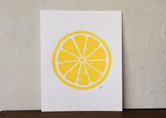 This original, hand-pulled linoleum cut print of a lemon on beautiful 100% cotton paper. The linoleum block is carved by hand, inked, then printed individually. Due to the printing process, there will