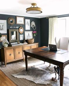 Dining Room // Office // Dark blue paint color; could be a great way to utilize a formal dining room