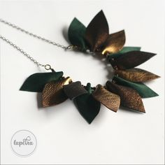 Beautiful statement necklace made of deep green and antique golden colored soft leather leaves. The jewelry is made of: - hematite beads: - leather leaves: 6 cm - antique golden coloured accessories - lenght cca 50 cm Leather Leaf, Soft Leather, Golden Color, Arrow Necklace, Drop Earrings, Beads, Antiques, Green, Accessories