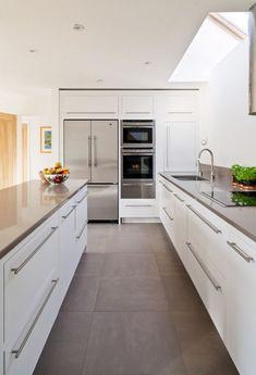 refrig, ovenwall, white cabinet, dark countertop, with big tile floor