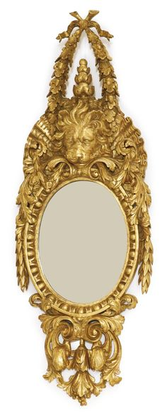A George II giltwood oval pier mirror in the manner of William Kent<br>circa 1740, 4.5'x19''W, $30K