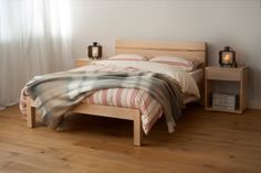 Solid wood bed from www.naturalbedcompany.co.uk - the Tibet bed in maple with a zebrano detail to the headboard. The cosy New England bedding and wool throw makes for a perfect Autumn/Winter scheme...