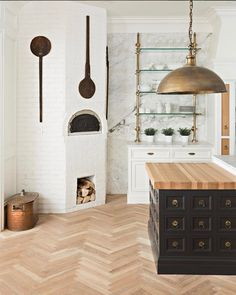 Black-and-white kitchen with white brick and chevron-patterned wood