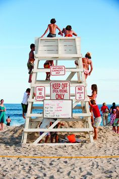 Kids taking over the lifeguard stand on Coopers Beach in Southampton, image featured in, In The Spirit of The Hamptons (® Gordon M. Grant)