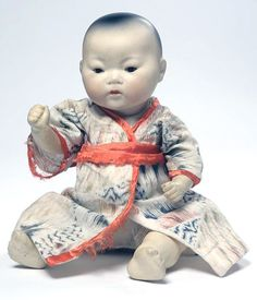 An Asian variation of the My Dream Baby doll, dressed in traditional clothing akin to those in Japan during the era, bisque and composition construction, made by Armand Marseille, 1924, Germany.
