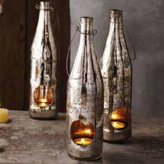 Check out the Mercury Glass Recycled Bottle Tealight Lantern in Candles & Holders, Decorative Accessories from Elizabeth's Embellishments for Mercury Glass Candle Holders, Bottle Candles, Bottles And Jars, Glass Bottles, Candle Chandelier, Candle Lanterns, Tall Lanterns, Beautiful Candles, Wine Bottle Crafts