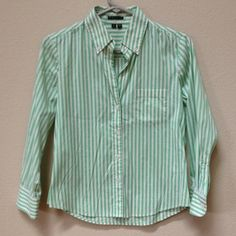 """Theory button down top This is a Theory button down top in gently worn condition. Size small. Stripes are green and white. Materials include 72% cotton, 23% polyamide and 5% spandex. Length down middle back from bottom of collar is 23"""" and approximate chest measurement is 18"""". Theory Tops Button Down Shirts"""