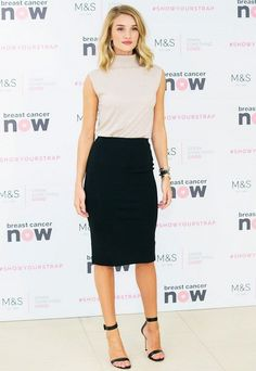 Rosie Huntington-Whiteley wears a nude turtleneck tank with a black pencil skirt and ankle strap heels.