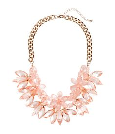 Short necklace in metal with flowers and pendants in faceted plastic. Adjustable length, 19 1/2 - 22 1/2.