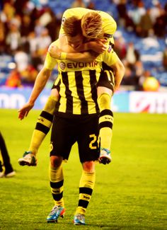 Łukasz Piszczek (Borussia Dortmund, front) and Marco Reus (Borussia Dortmund, back)