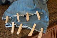 Use clothespins on the cuff of your pants in the dryer to get the cuff to dry down and flat
