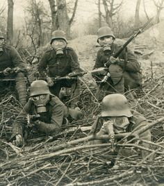 Detail, right side - A German Gruppen in respirators, with Kar98 rifles, creeping up on the camera. They are members of IR 167. The IR 167 saw action on the Eastern Front as well as the Western Front where they took part in the Spring Offensives of 1918.