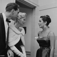 Actress Elizabeth Taylor (1932 - 2011) chats with Eva Marie Saint and her husband, director and producer Jeffrey Hayden at a showing of the film 'Raintree County' in Los Angeles, October 1957.