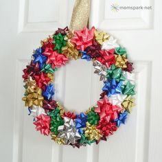 What a cute DIY idea for a wreath! These large bows for Christmas presents are always easy to find around the holidays, and make into this awesome wreath!