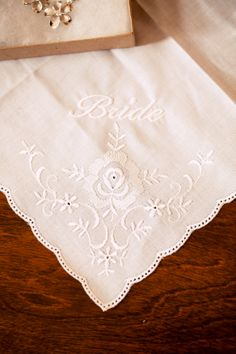 A timeless, elegant handkerchief for the bride. ::Katie + Tom's bright and lovely beachside wedding at the Rancho Guajome Adobe in Vista, California:: #bride #accessoryideas #kerchiefs #weddingphotography #weddingdetails