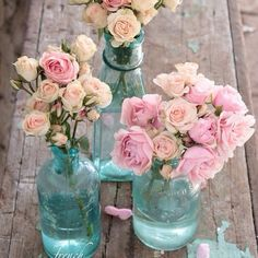 Coloured glass bottles are a pretty touch to a table centre pieces