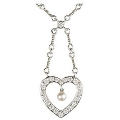 For Sale on - An elegant diamond and pearl necklace in platinum by Tiffany & Co. The necklace is set with a single round brilliant cut diamond leading on to an open Pink Pearl Necklace, Pendant Necklace, Tiffany And Co, A 17, Cultured Pearls, Fancy, Chain, Elegant, My Style