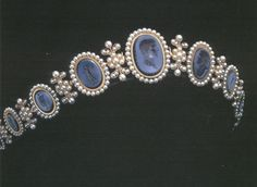 Caroline Bonaparte's bandeau.  The cameos in this diadem are made from coral, each piece of which has color variations. It is set in gold with lapis-lazuli inlay.  This diadem is made from lapis cameos and delicate pearls set in gold. The center cameo portrays Napoléon Bonaparte.