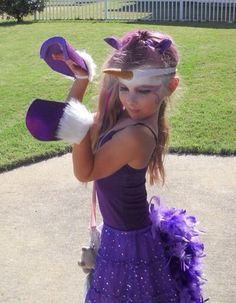 Unicorn costume in purple.