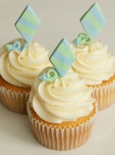 let's go fly a kite cupcakes.  love the Amy Atlas style of printables on picks with cupcakes, but love the eco-chic idea of fondant or cookie tags more - less paper waste after the party.