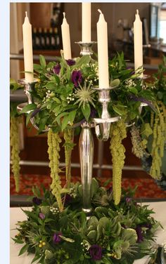 One of many candelabra styles. This design is extremely affordable with hints of colour, but mainly foliage. Our customers love this - their weddings have an extremely romantic atmosphere without costing a fortune unlike most candelabra designs.