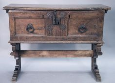 Italian lift top chest having inlaid rectangular lift top opening to reveal inlaid interior lid, false bottom, and two tills, front having two panels with large hand etched iron decorations and lock all on stand with tressel type base, walnut probably 17th century.  ht. 37 in.; wd. 43 in.; dp. 14 1/2 in. Realized Price: $3,900.00