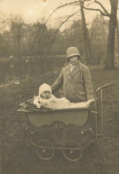 Old Victorian Sepia photographs.  Great baby buggy.