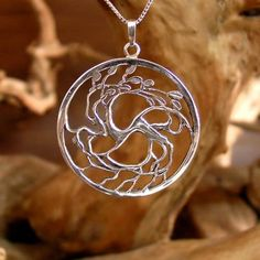 Tree of Love Silver Pendant - Yin Yang Symbol of Love and Harmony. Tree of Love pendant The image of the branches and the roots hides within it the ancient Yin Yang symbol.  The Yin Yang is an ancient Asian philosophical outlook that sees polar opposites or opposite powers as powers that complete and define each other.  Opposite powers constitute a point of relationship and they complete and balance each other.