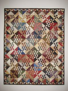 Pinwheel Garden pattern by Primitive Gatherings - gorgeous little quilt on my must make list