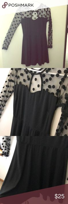 Black Mesh Polka Dot Dress Gorgeous! Excellent like new. Worn once to a wedding. Size L. Sheer sleeves and chest, body is a black polyester material. Stretchy fit. Lulu's Dresses Mini