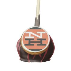 New Haven Railroad Logo Cake Pops - $44.95 -Make your party pop with a dozen bite-sized desserts from Veronica's Treats! Handmade with a secret combination of ingredients, these cake pops are insanely moist and extraordinarily delicious! Choose from three cake flavors, three flavors of icing, and eleven drizzle colors to custom build a cake pop that suits your taste. Then, customize the front of your cake pops with designs or photos to match your occasion or theme.