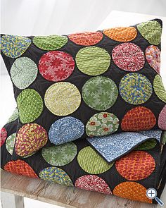 love this quilt with circles with black background