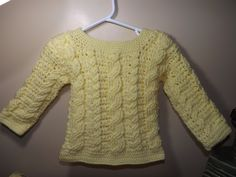 Bernat Baby, Baby yellow, and crochet hook 3.75mm, I'm not sure what size will fit this sweater maybe after the 6 month.