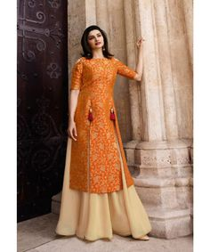 This Banarasi Jacquard And Satin Orange And Cream Colour Kurti Is The Fun Attire Of The Moment. Get It and Style It With Handbag and Earrings For The Perfect Day Look. Its Party Wear and Cute - The. Stylish Dress Designs, Dress Neck Designs, Designs For Dresses, Stylish Dresses, Party Wear Maxi Dresses, Designer Party Wear Dresses, Indian Designer Outfits, Party Wear Indian Dresses, Party Wear Kurtis
