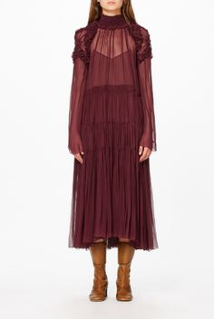 The Vogue Edit. This silk mousseline midi dress is one of Chloé's signature wear-forever styles. The ruched shoulder detailing and fluted sleeves add just enough detail and it comes with a coordinating slip to offset the sheerness. The romantic style has been given a bold update with this season's oxblood red hue.