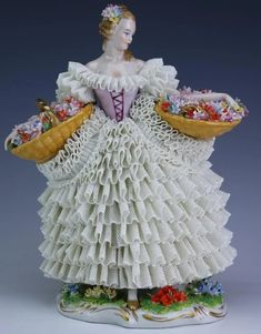 Features the form of a woman with two large baskets of flowers. Dresden Porcelain, China Porcelain, Porcelain Lamps, Porcelain Doll, Dresden Dolls, Half Dolls, Ceramic Figures, China Dolls, Victorian Women