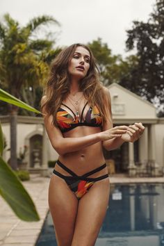 Strap detailed Athena bikini in the black strelitzia print by Emijl De Kock. Fitted cups with clasp detailed back. Soul Design, Bikinis, Swimwear, Things I Want, Thong Bikini, Jewelry Design, African, The Incredibles, Fitness