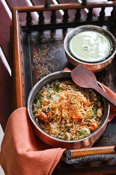 Vegetable Biryani - cauliflower, carrots peas, beans in a gravy of yogurt, tomatoes, and Indian spices. Served with basmati rice, topped with cashews and fried onions.