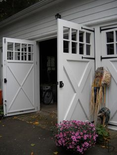 1000 ideas about carriage garage doors on pinterest for Swing out garage doors price