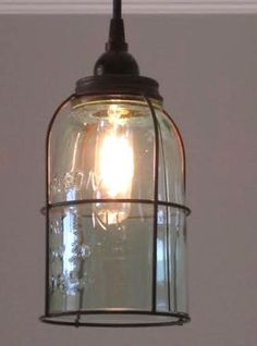 """Great Pendant light!! Do you love mason jars?Here you have a single half gallon jar with a rust """"cage"""" and the bottom cut out. The glass does have a slight gree"""