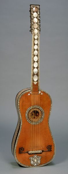 Attributed to Giacomo (Jacob) Ertel (German, ca. 1646–1711 Rome). Checkerboard patterns of bone, ebony, and fruitwood decorate the back, sides, and neck of Ertel's guitar. The peghead, fingerboard, and top have inlaid ornaments of mother-of-pearl. The modern rosette of wood and parchment is a replacement. Formerly converted to six single strings, this instrument was later restored to its five-course configuration.